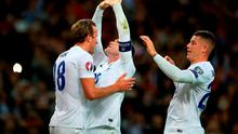 England's Wayne Rooney (centre) celebrates scoring his sides second goal and his fiftieth for England during the UEFA European Qualifying match at Wembley
