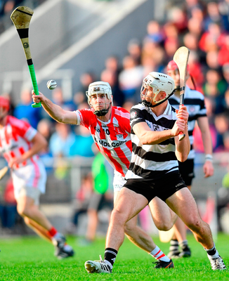 Midleton's Seán O'Leary-Hayes in action against Brian Lawton of Imokilly. Photo by Ramsey Cardy/Sportsfile