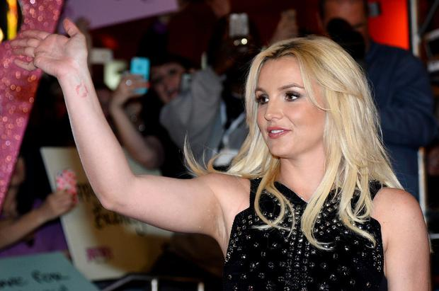 """LAS VEGAS, NV - DECEMBER 03:  Singer Britney Spears waves at a welcome ceremony as she celebrates the release of her new album """"Britney Jean"""" and prepares for her two-year residency at Planet Hollywood Resort & Casino on December 3, 2013 in Las Vegas, Nevada. Spears' show """"Britney: Piece of Me"""" will debut at the resort on December 27, 2013.  (Photo by Ethan Miller/Getty Images)"""