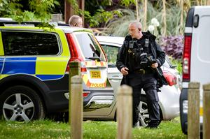 An armed police officer inside the Oxford University Parks, after the bodies of a 44-year-old man, a 46-year-old woman and a six-year-old girl were discovered in a house in Vicarage Road, Didcot, Oxfordshire, after officers were called by a member of the public last night. Ben Birchall/PA Wire