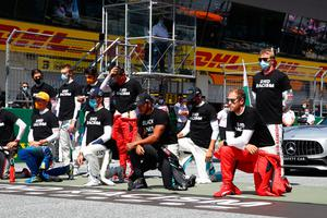 Lewis Hamilton of Mercedes GP and some of the F1 drivers take a knee on the grid in support of the Black Lives Matter movement ahead of the Austrian Grand Prix in Spielberg, Austria. Photo: Mark Thompson/Getty Images