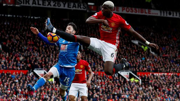 Bournemouth's Adam Smith handles the ball from Paul Pogba's cross. Photo: Reuters
