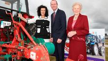 Minister for Agriculture Simon Coveney with Anna May McHugh National Ploughing Association (NPA) managing director and Anna Marie McHugh, NPA assistant managing director at a previous staging of the National Ploughing Championships.