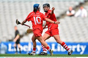14 September 2014; Cork's Jennifer O'Leary, left, celebrates with team-mate Angela Walsh after Walsh scored her side's second goal. Liberty Insurance All Ireland Senior Camogie Championship Final, Kilkenny v Cork, Croke Park, Dublin. Picture credit: Ramsey Cardy / SPORTSFILE