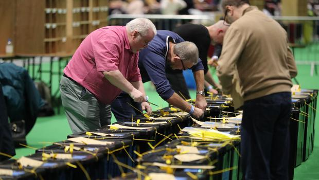 Ballot boxes are opened at the RDS in Dublin (Niall Carson/PA)