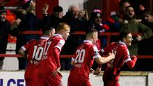 Jaze Kabia of Shelbourne, right, celebrates with team-mates after scoring his side's winning goal during the SSE Airtricity League Premier Division match against St Patrick's Athletic at Tolka Park in Dublin last month. Photo by Michael P Ryan/Sportsfile