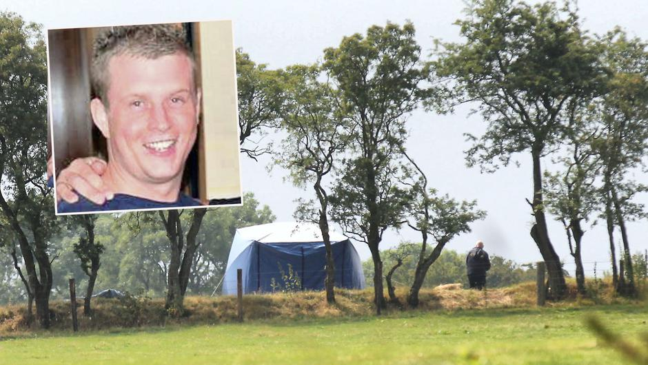 Gardai at the scene at Ballymacan, Co. Meath where the body of Paul Gallagher (inset) was found.