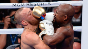 Floyd Mayweather Jr (right) in action againstConor McGregor during their boxing match at T-Mobile Arena   Pic: USA Today