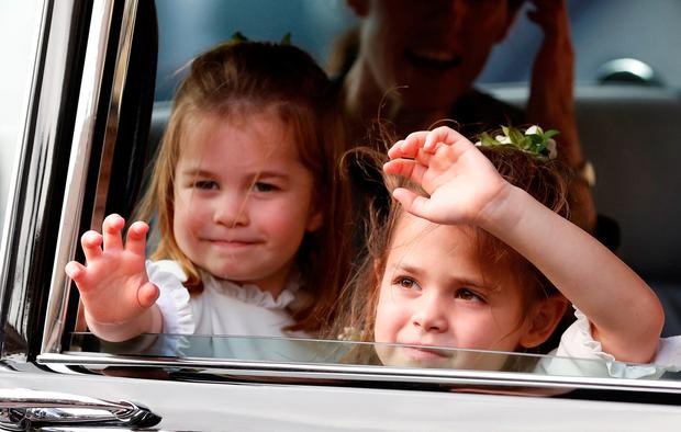 Flower Girls Princess Charlotte, left and Theodora Williams wave to the crowds following the wedding of Princess Eugenie of York and Jack Brooksbank in St George's Chapel, Windsor Castle, Windsor, Britain, October 12, 2018. Alastair Grant/Pool via REUTERS