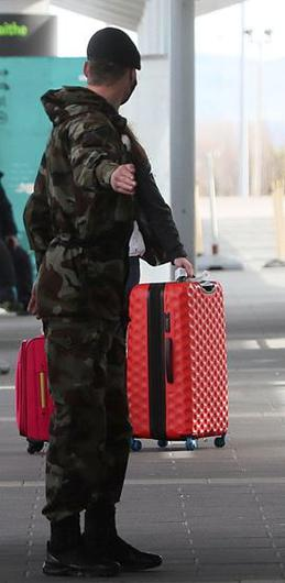 A member of the defence forces directs a passenger arriving at Dublin Airport from one of 33 high risk countries who will be transported to a mandatory 12-day hotel quarantine Photo: Brian Lawless/PA Wire