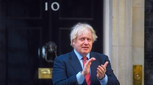 Staying put: Prime Minister Boris Johnson at Downing Street taking part in the weekly Clap For Carers. Photo: Kirsty O'Connor