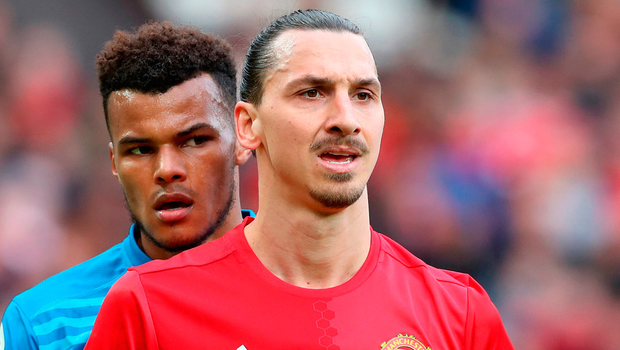 Tyrone Mings and Zlatan Ibrahimovic had a running battle during Saturday's draw at Old Trafford Photo: Martin Rickett/PA Wire