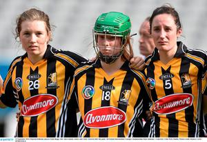 14 September 2014; Dejected Kilkenny players Sonia Buggy, left, Aine Gannon, centre, and Claire Aylward after the game. All Ireland Intermediate Camogie Championship Final, Kilkenny v Limerick, Croke Park, Dublin. Picture credit: Ramsey Cardy / SPORTSFILE