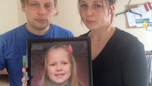Paula Dinsberga's devastated parents Linda (right) & Raivo, holding a picture of their deceased daughter.