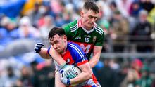 BRONX BATTLE: New York's Robert Gorman shields the ball from James Carr of Mayo during their Connacht SFC clash in New York last May. Photo: Piaras Ó Mídheach/Sportsfile