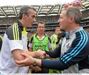 31 August 2014; Donegal manager Jim McGuinness with Dublin manager Jim Gavin at the end of the game. GAA Football All Ireland Senior Championship, Semi-Final, Dublin v Donegal, Croke Park, Dublin. Picture credit: David Maher / SPORTSFILE