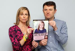 Never giving up hope: Kate and Gerry McCann pose with a computer-generated image of how their missing daughter Madeleine might look as an older girl. REUTERS/Andrew Winning/File Photo