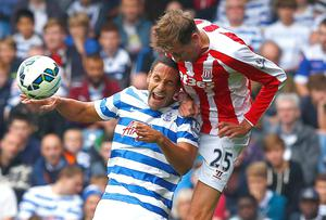 Rio Ferdinand loses out to Peter Crouch in an aerial duel during QPR's draw against Stoke City. Photo: REUTERS/Eddie Keogh
