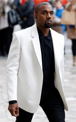 US singer Kanye West arrives at St Paul's Cathedral in central London, on February 20, 2015, to attend a memorial service for Louise Wilson