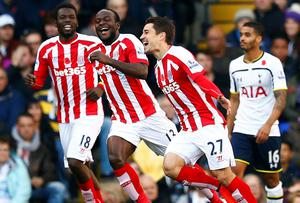 Stoke City's Bojan Krkic (R) celebrates his goal against Tottenham Hotspur with Mame Diouf (L) and Victor Moses. Photo credit: REUTERS/Eddie Keogh