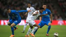 England's Raheem Sterling (centre) gets the better of Slovenia's Andraz Struna. Photo credit: Nick Potts/PA Wire