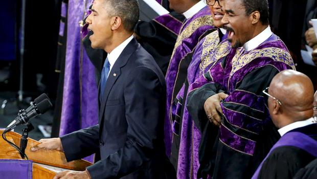 """U.S. President Barack Obama  leads mourners in singing the song """"Amazing Grace"""" as he delivers a eulogy in honor of the Rev. Clementa Pinckney during funeral services for Pinckney in Charleston, South Carolina June 26, 2015. Pinckney is one of nine victims of a mass shooting at the Emanuel African Methodist Episcopal Church.   REUTERS/Jonathan Ernst"""