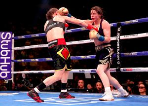 Katie Taylor (right) in action against Delfine Persoon in the IBF, WBC, WBO, WBA, Ring Magazine Women's Lightweight World Championships fight at Madison Square Garden, New York last June. Nick Potts/PA Wire.