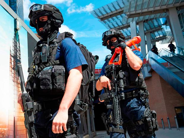 Armed police officers patrol outside The Shard tower and London Bridge railway station in London. Photo: Getty