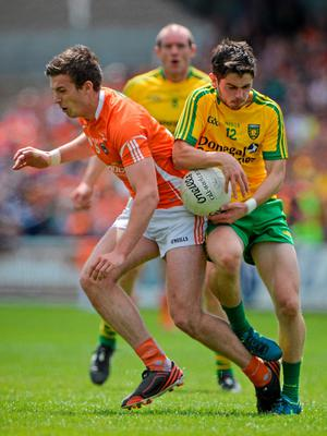 14 June 2015; Mark McHugh, Donegal, in action against Ethan Rafferty, Armagh. Ulster GAA Football Senior Championship Quarter-Final, Armagh v Donegal. Athletic Grounds, Armagh. Picture credit: Brendan Moran / SPORTSFILE