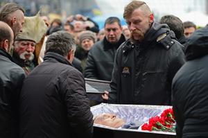 A funeral of an anti-government demonstrator takes place Independence square in Kiev, Ukraine