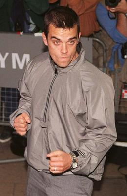Robbie Williams arrives for the premiere of the film Lock Stock and Two Smoking Barrels, at the Virgin Haymarket, in 1999.  Photo by Michael Stephens/PA