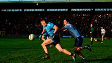 Dublin's Con O'Callaghan is chased by Ryan Wylie of Monaghan in front of a packed stand at Clones last Sunday. Photo: Ramsey Cardy/Sportsfile