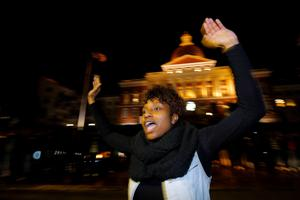 "A woman leads the chant ""Hands Up, Don't Shoot"" as demonstrators react to the grand jury decision in the shooting death of unarmed black teenager Michael Brown, in front of the State House in Boston, Massachusetts November 25, 2014. REUTERS/Brian Snyder"