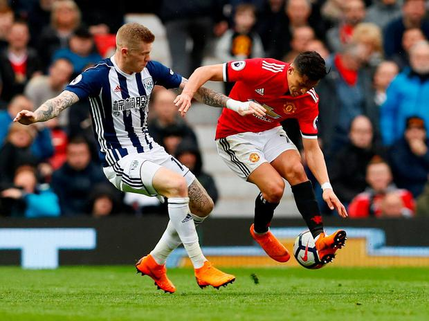 Manchester United's Alexis Sanchez in action with West Bromwich Albion's James McClean. Photo: Jason Cairnduff/Action Images via Reuters