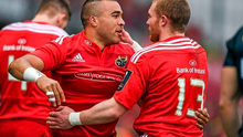 Simon Zebo, Munster, is congratulated by team-mate Keith Earls, after scoring his side's first try. European Rugby Champions Cup 2014/15, Pool 1, Round 6, Munster v Sale Sharks. Thomond Park, Limerick (Diarmuid Greene / SPORTSFILE)