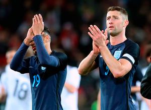 England's Jesse Lingard (left) and Gary Cahill applaud the away fans