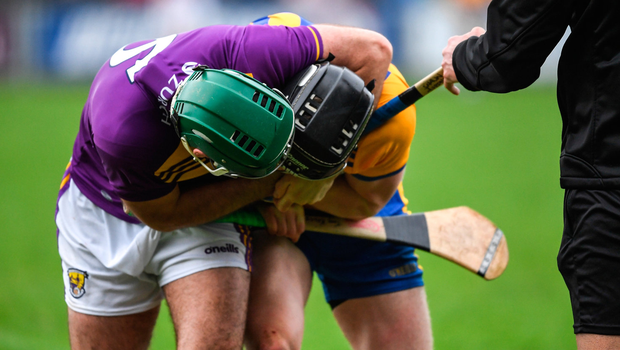 Shaun Murphy of Wexford and Tony Kelly of Clare jostle each other near the end of the match. Photo by Ray McManus/Sportsfile