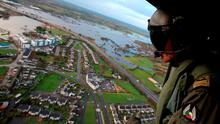 Air Corps officer Craig Cullen looks out over floods in Athlone, Co Westmeath. Niall Carson/PA Wire