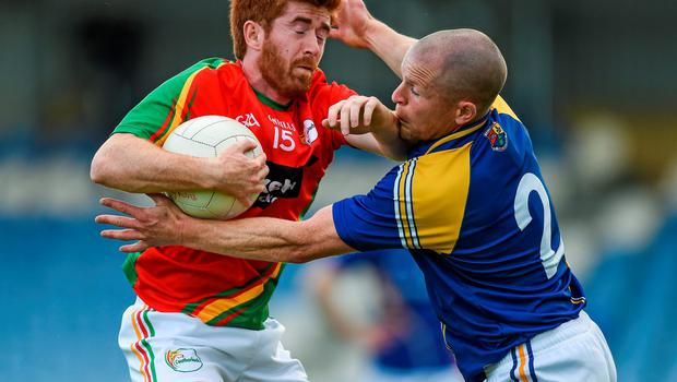 Carlow's Daryl Roberts can find no way past a determined Longford captain Dermot Brady during Saturday's SFC qualifier at Pearse Park
