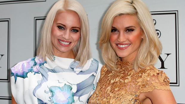 Kimberly Wyatt and Ashley Roberts attends a photocall to launch the KEY Fashion brand at Vanilla on September 25, 2013 in London, England.