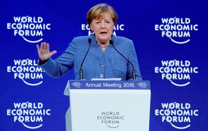 German Chancellor Angela Merkel gestures as she addresses a speech during the World Economic Forum (WEF) annual meeting in Davos, Switzerland January 24, 2018.  REUTERS/Denis Balibouse