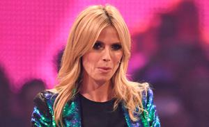 """German model and jury member Heidi Klum performs on stage during the German television casting show """"Germany's Next Topmodel"""" in Mannheim, Germany, Thursday, May 14, 2015. The shows was abandoned after a woman called in a bomb threat. (Uwe Anspach/dpa via AP)"""