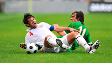 Georgia's Kakha Kaladze and is tackled by Stephen Hunt during the 2010 World Cup qualifier in Mainz. Photo: David Maher / Sportsfile