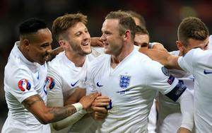 England's Wayne Rooney (centre) celebrates after team-mate Danny Welbeck scores their second goal during the UEFA Euro 2016 Group E Qualifying match at Wembley Stadium