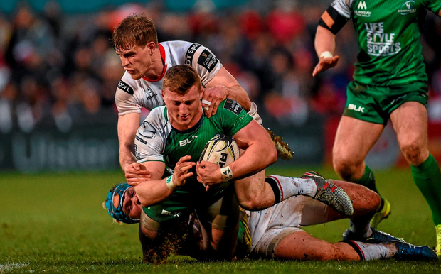Connacht's Peter Robb is tackled by Andrew Trimble during Friday night's Pro12 clash at Ravenhill. Photo: Oliver McVeigh / Sportsfile