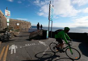 Social distancing guidelines at the Forty Foot in Sandycove, Dublin. Photo: Brian Lawless/PA Wire