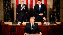 U.S. President Donald Trump pauses as he speaks in front of Vice President Mike Pence (L) and Speaker of the House Paul Ryan. REUTERS/Jim Bourg