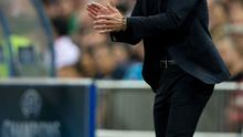 Diego Simeone encourages his Atletico Madrid players during their game against Real