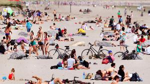 Flocking to seaside: The hot weather has brought crowds of people to beaches such as Dollymount Strand in Dublin. Photo: Steve Humphreys