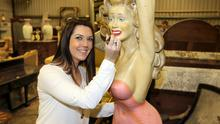 Eimear Dunne, from Mullingar touches up the lipstick on a statue of Marilyn Monroe at the Palmerstown House Estate contents auction held by ashgrove auction rooms. Picture credit; Damien Eagers